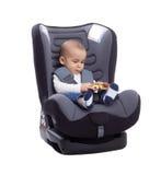 Ребенок младенца в автокресле играя с игрушкой Стоковая Фотография RF