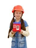 有玩具房子的好小女孩 免版税库存照片