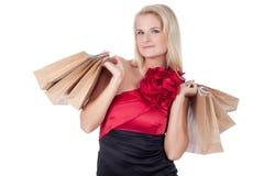 有购物袋的女孩 免版税图库摄影