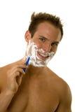 刮胡须他的刮年轻人的人 库存图片