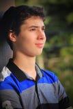 作白日梦青少年的男孩 免版税库存照片