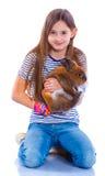 女孩用兔子 免版税库存照片