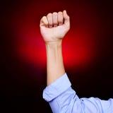 Поднятый кулак молодого человека Стоковое Фото