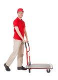 Работник доставляющее покупки на дом с вагонеткой коробок Стоковое Изображение
