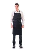 全长射击年轻厨师或侍者摆在 免版税图库摄影