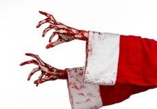 圣诞节和万圣夜题材:在白色背景的圣诞老人蛇神血淋淋的手 免版税图库摄影