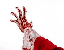 圣诞节和万圣夜题材:在白色背景的圣诞老人蛇神血淋淋的手 免版税库存图片