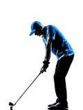 Силуэт качания гольфа игрока в гольф человека играя в гольф Стоковые Изображения RF