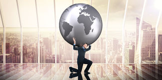 Σύνθετη εικόνα του επιχειρηματία που φέρνει τον κόσμο Στοκ Φωτογραφία