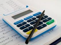 银行计算器编号针安全铁笔 免版税库存照片