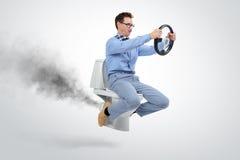 在洗手间的滑稽的商人飞行 库存图片