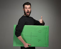 作为商人的微笑的人与绿色盘区 免版税图库摄影