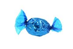 蓝色被包裹的糖果 库存照片