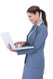 拿着膝上型计算机的确信的女实业家的图象 免版税库存图片