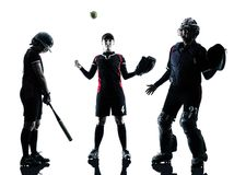演奏垒球运动员剪影的妇女被隔绝 库存图片