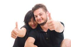 美好的年轻夫妇显示象的或翘拇指 库存照片