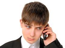 有手机的哀伤的少年 免版税库存照片