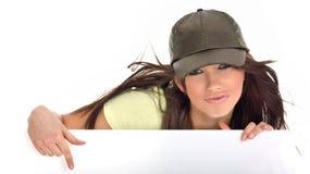 拿着性感的妇女的广告牌 免版税库存照片