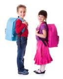相当小女小学生和男小学生 免版税库存照片