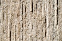 在墙壁上的装饰安心金属平板仿效石头 免版税库存照片