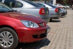 припаркованная компания автомобилей Стоковое Изображение