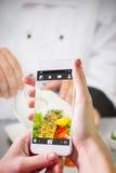 拿着智能手机的手的综合图象 库存图片