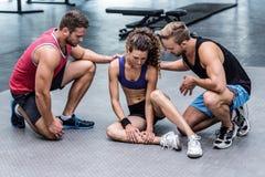 有肌肉的妇女肌肉伤 库存图片