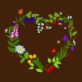 与花和莓果的心形的框架 库存图片