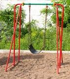 Качание спортивной площадки ребенк современное красное Стоковые Фото