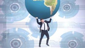 Σύνθετη εικόνα του επιχειρηματία που φέρνει τον κόσμο Στοκ Εικόνες