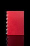 примечание изолированное книгой Стоковые Фотографии RF