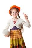盔甲的愉快的小女孩与图纸 免版税库存图片