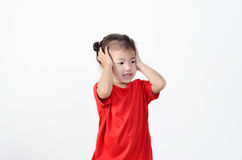 学龄前儿童的女孩画象有头疼 免版税库存图片