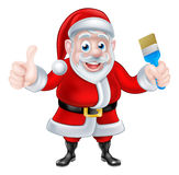 动画片给赞许和拿着油漆刷的圣诞老人 库存图片