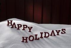 圣诞节词节日快乐在雪 免版税库存图片