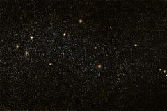 星际,金黄和银色星,空间背景 免版税库存图片