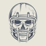 在踢橄榄球的盔甲的头骨 免版税库存照片