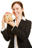 有存钱罐的妇女当金钱投资 库存图片