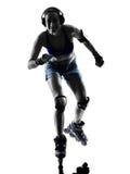 Женщина в силуэте коньков ролика Стоковое Изображение RF