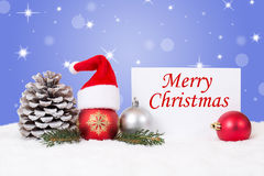 与装饰品、星和帽子装饰的圣诞快乐卡片 免版税库存图片