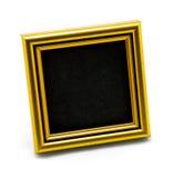 在白色隔绝的方形的经典空的金照片框架 图库摄影