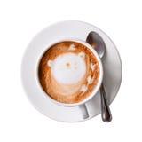 有在与裁减路线的白色隔绝的茶碟的热奶咖啡杯子 顶视图 库存图片