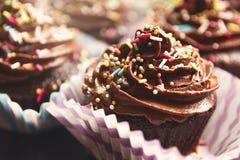 巧克力杯形蛋糕 免版税库存图片