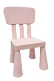 桃红色孩子塑料椅子或凳子 免版税库存图片