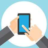触摸屏幕智能手机在您的手上 免版税库存照片