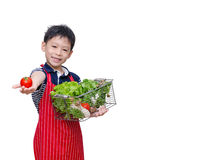 有新鲜蔬菜的男孩 库存照片