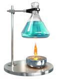 有液体的测试管在酒精灯 免版税库存照片