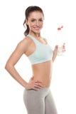 运动的从一个瓶的女孩饮用水在锻炼以后,健身训练,隔绝在白色背景 库存图片