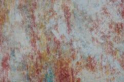 红色蓝色黄色老难看的东西水泥墙壁背景纹理 库存照片