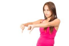 不赞成亚洲女性拇指下来描出  库存图片